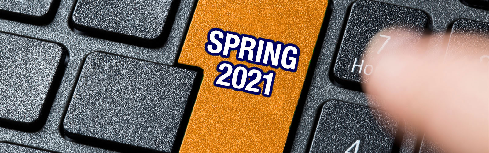 Spring 2021 printed on a keyboard button