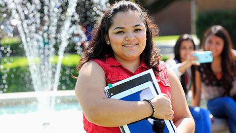 student grabbing book