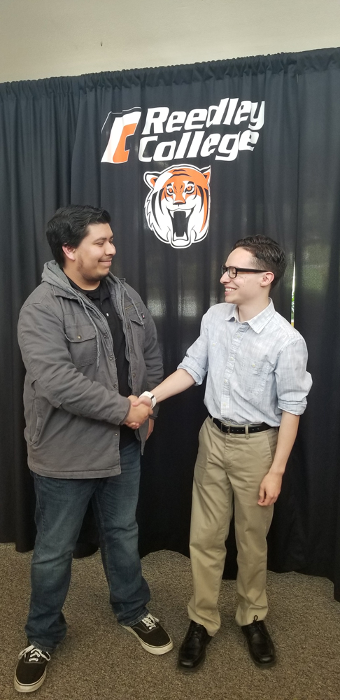 Gerardo Reyes and Brighten Tompkins shook hands following the open forum.